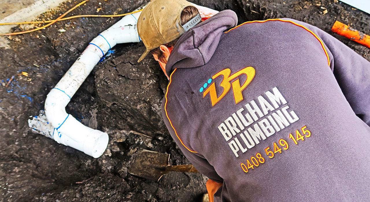 plumber draining blocked drain in melbourne
